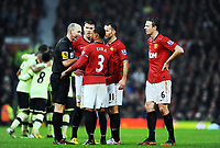 Jonny Evans and Manchester United players confront Referee Mike Dean after Newcastle United's 2nd goal<br /> Manchester United 2012/13<br /> Manchester United V Newcastle United 26/12/12<br /> The Premier League<br /> <br /> Norway only