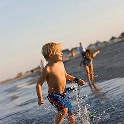 Kids and her boogie board at Hampton Beach in Hampton Beach, New Hampshire.