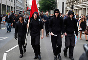 Anti capitalists / anarchists also known as Black Watch gather in central London on the back of the peaceful Genreal Strike march. The masked demonstrators ran up Whitehall where they were controlled by police, searched, and some arrested. Demonstration in Central London on a day of General Strike action by public sector workers and unions. Civil servants, teachers, health workers all came out on a day of peaceful march and protest against government cuts which look set to see their pensions change.