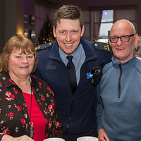 Breda Collins and Malcom Simpson from Shannon with Garda Robert Reidy