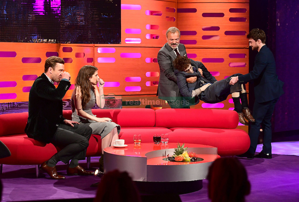 Host Graham Norton and Daniel Radcliffe carry in the life size model of the Harry Potter actor used in the film Swiss Army Man as Justin Timberlake and Anna Kendrick look on during filming of The Graham Norton Show at the London Studios in London, to be aired on BBC1 on Friday evening.