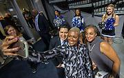 Houston ISD Trustee Jolanda Jones takes a photograph with Superintendent Richard Carranza and Trustee Rhonda Skillern-Jones during a grand opening ceremony at Delmar Fieldhouse, February 10, 2017.