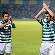 Bursaspor's Ali TANDOGAN (C) and Volkan SEN (L) during their Turkish soccer super league match Bursaspor between Kayserispor at Ataturk Stadium in Bursa Turkey on Saturday, 01 May 2010. Photo by TURKPIX