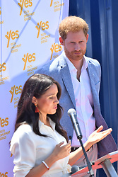 The Duke of Sussex watches as his wife, the Duchess of Sussex, makes a speech during a visit to Tembisa township near Johannesburg, where they met with local youth entrepreneurs and viewed skills initiatives addressing the rising unemployment challenge faced by youth in South Africa, on the last day day of their tour in Africa.