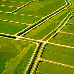 Aerial art abstract of a farm in Lshowing geometry of lines in the earth.
