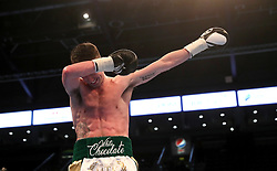 Tyrone McCullagh celebrates after victory over Elvis Guillen during their International Featherweight bout at the SSE Arena, Belfast.