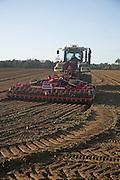 Sumo Quatro Multipaka cultivator drawn by Claas tractor cultivating field Rendlesham Suffolk England December 2007