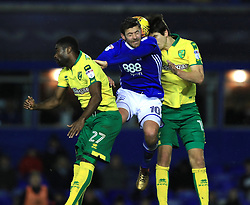 Birmingham City's Lukas Jutkiewicz and Norwich City's Alex Tetley and Tim Klose battle for the ball