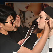 Designer Nina Naustdal perparing (backstage) catwalk show s/s 2019/2020 collection by The London School of Beauty & Make-up at Bagatelle on 26 Feb 2019, London, UK.