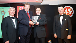 CARDIFF, WALES - Tuesday, October 7, 2008: Wales' manager John Toshack picks up the 2008 Club Player of the Year award on behalf of Joe Ledley from FAW President Peter Rees along with Stewart Dobson, Head of Marketing at Brains, and David Collins, General Secretary of the FAW at the Brains Beer Wales Football Awards at the Millennium Stadium. (Photo by David Rawcliffe/Propaganda)