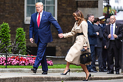 © Licensed to London News Pictures. 04/06/2019. London, UK. President of the United States Donald Trump and Melania Trump arrive on Downing Street. President Trump is in the UK for a three-day State Visit. Photo credit: Rob Pinney/LNP