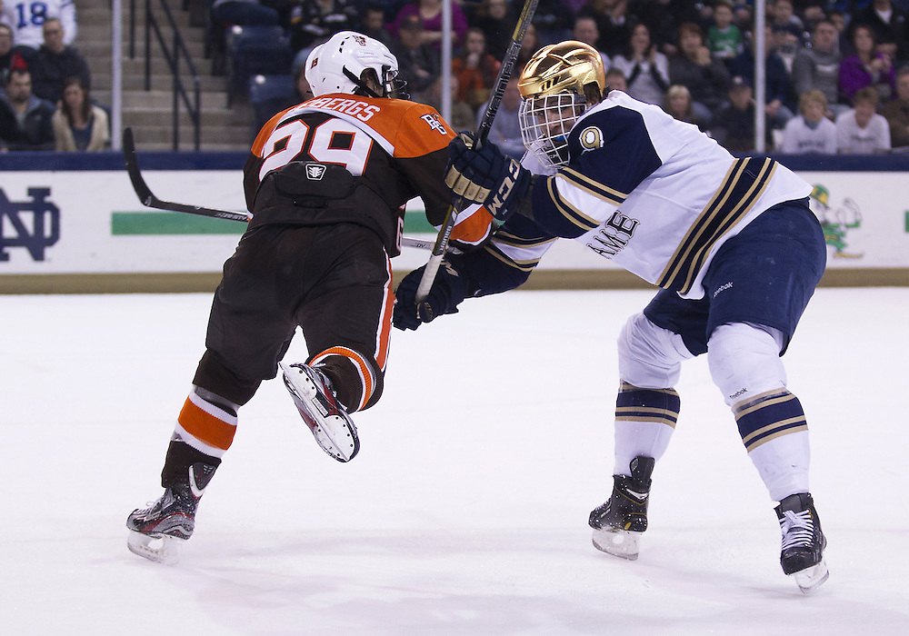 March 15, 2013:  Bowling Green defenseman Ralfs Freibergs (29) and Notre Dame center Anders Lee (9) during NCAA Hockey game action between the Notre Dame Fighting Irish and the Bowling Green Falcons at Compton Family Ice Arena in South Bend, Indiana.  Notre Dame defeated Bowling Green 1-0 in overtime.