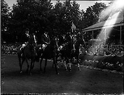 """05/08/1960<br /> 05/08/1960<br /> 05 August 1960<br /> R.D.S Horse Show Dublin (Friday). Aga Khan Trophy. The English Team was second in the Aga Khan Trophy International Jumping Competition at the Dublin Horse Show. (l-r): Miss Pat Smythe on """"Flanagan""""; David Barker on """"Franco""""; Mrs Dawn Wofford on """"Hollandia"""" and David Broome on """"Sunsalve""""."""