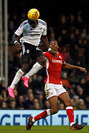 Aboubakar Kamara of Fulham (L) wins a header in the air. EFL Skybet championship match, Fulham v Barnsley at Craven Cottage in London on Saturday 23rd December 2017<br /> pic by Steffan Bowen, Andrew Orchard sports photography.