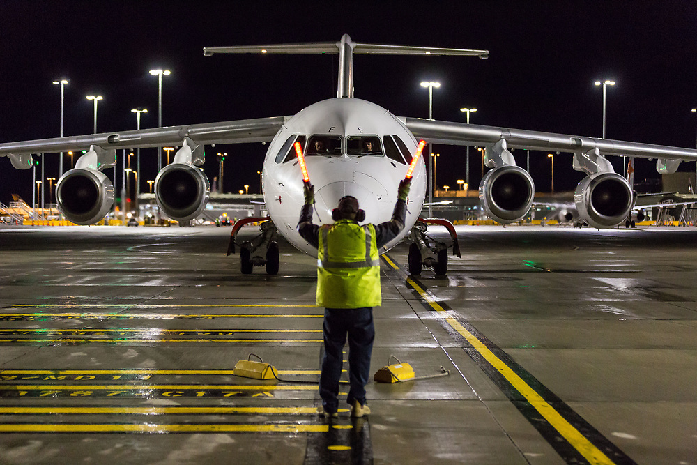 A Qantas plane landing at Sydney airport at night.  Shot for a business story for Qantas Freight
