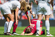 Lucy Bronze (England) being supported by Alex Greenwood (England) & Katie Bowen (New Zealand) during the FIFA Women's World Cup UEFA warm up match between England Women and New Zealand Women at the American Express Community Stadium, Brighton and Hove, England on 1 June 2019.