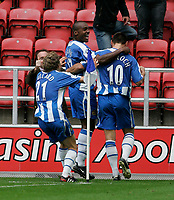 Photo: Dave Howarth.<br />Wigan Athletic v Bolton Wanderers. The Barclays Premiership. 02/10/2005. Lee McCullock celebrates his goal