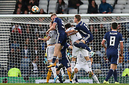 Scotland forward Oliver McBurnie (9) (Sheffield United) and Scotland midfielder Scott McTominay (6) (Manchester United) get to the high ball to put early pressure on the Russia defence during the UEFA European 2020 Qualifier match between Scotland and Russia at Hampden Park, Glasgow, United Kingdom on 6 September 2019.