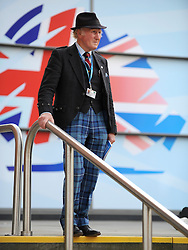 © Licensed to London News Pictures. 03/10/2011. MANCHESTER. UK. A delegate walks down a set of stairs in front of a conservative party logo at The Conservative Party Conference at Manchester Central today, October 3, 2011. Photo credit:  Stephen Simpson/LNP
