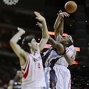 Feb 5, 2011; Houston, TX, USA; Houston Rockets small forward Shane Battier (31) blocks Memphis Grizzlies power forward Darrell Arthur (0) during the fourth quarter at the Toyota Center. The Rockets won 95-93. Mandatory Credit: Thomas Campbell-US Presswire