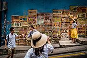 Hong Kong, China - Tourists pose for photographs in front of street art along Graham Street in Hong Kong's SoHo district on April 30, 2018. From graffiti shows to major installations, Hong Kong will see a creative surge as Art Basel comes to town this week, but residents want a more permanent change to the visual landscape.Hong Kong, Chine - Le 30 avril 2018, des touristes posent pour des photos devant des œuvres d'art de rue le long de Graham Street dans le quartier SoHo de Hong Kong. Des spectacles de graffiti aux grandes installations, Hong Kong connaîtra un essor créatif avec l'arrivée d'Art Basel en ville cette semaine, mais les habitants veulent un changement plus permanent dans le paysage visuel.