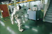 Ten years and tens of millions of dollars in the making, the Honda P3 strides down its course at the car company's secret research facility on the outskirts of Tokyo, Japan. The product of a costly decade-long effort, the Honda robotic project was only released from its shroud of corporate secrecy in 1996. In a carefully choreographed performance, P3 walks a line, opens a door, turns a corner, and, after a safety chain is attached, climbs a flight of stairs. From the book Robo sapiens: Evolution of a New Species, page 34-35.