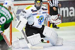 19.10.2012. Hala Tivoli, Ljubljana, SLO, EBEL, HDD Telemach Olimpija Ljubljana vs Dornbirner Eishockey Club, 13. Runde, in picture Jan Mursak (HDD Telemach Olimpija, #13) scores a goal on Patrick Desrochers (Dornbirner Eishockey Club, #37) during the Erste Bank Icehockey League 13th Round match betweeen HDD Telemach Olimpija Ljubljana and Dornbirner Eishockey Club at the Hala Tivoli, Ljubljana, Slovenia on 2012/10/19. (Photo By Matic Klansek Velej / Sportida)