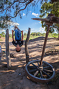 2014/11/22 – Quimili, Argentina: Lautero Carrizo (8), plays in the backyard of his house. Children run and play with total freedom during the day in the Guaycurú Indigenous Community. (Eduardo Leal)