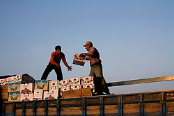 Workers load tomatoes onto a truck at the Central de Abasto, Mexico's main fruit and vegetable market, on Tuesday, October 20, 2009, in Mexico City, Mexico.