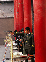 Chinese soldier in week-end shooting for fun.