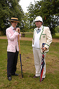 Gwilym Evans and Philip Corbett. The Dangerous Sports Club host the innauguaral Oxford V  Cambridge Punt Race. University Parks. Oxford. 25 June 2005. 25 June 2005. ONE TIME USE ONLY - DO NOT ARCHIVE  © Copyright Photograph by Dafydd Jones 66 Stockwell Park Rd. London SW9 0DA Tel 020 7733 0108 www.dafjones.com