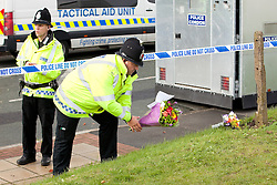 © Licensed to London News Pictures . Mottram , UK , 18/09/2012 .Well wishers deliver flowers at the scene on Abbey Gardens , Mottram , Tameside , where one officer died and another was fatally wounded . Fugitive Dale Cregan has been arrested on suspicion of the murder of a police officer and other murders . Photo credit : Joel Goodman/LNP