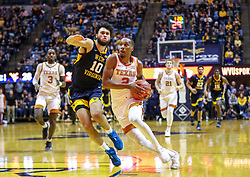 Feb 9, 2019; Morgantown, WV, USA; Texas Longhorns guard Matt Coleman III (2) drives down the lane defended by West Virginia Mountaineers guard Jermaine Haley (10) during the first half at WVU Coliseum. Mandatory Credit: Ben Queen-USA TODAY Sports