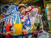 "20 APRIL 2013 - BANGKOK, THAILAND:   A ""slushy"" vendor makes crushed iced drinks in Talat Noi (Talat means Market, Noi means Small. Literally Small Market). The Talat Noi neighborhood in Bangkok started as a blacksmith's quarter. As cars and buses replaced horse and buggy, the blacksmiths became mechanics and now the area is lined with car mechanics' shops. It is one the last neighborhoods in Bangkok that still has some original shophouses and pre World War II architecture. It is also home to a  Teo Chew Chinese emigrant community.   PHOTO BY JACK KURTZ"