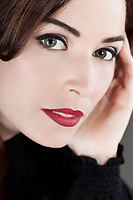 Close-up portrait of a beautiful middle aged woman with beautiful red lips