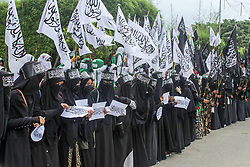 November 1, 2018 - Lhokseumawe, Aceh, Indonesia - Female demonstrators seen during the rally. .Muslims throughout Indonesia held protests against the burning of the Tauhid Islamic flag in front of the Lhokseumawe Islamic Center Mosque..Violent protests by Indonesian Muslims after the circulation of videos of burning the Tauhid Islamic flag (La Illah ha illallah Muhammaddurrasulullah) by a number of BANSER (Multipurpose Ansor Barisan) members. (Credit Image: © Maskur Has/SOPA Images via ZUMA Wire)