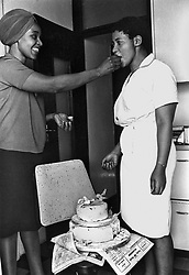 DM2001022612:GCP:SOCIAL:PERSONALITY :19SEP1970 - Miss Winnie Mandela with a neighbour at her house in Orlando.  Day Of Tears And Joy. The Terrorist Act trial.  Mr Justice Viljoen handed down an 84-page judgement when he cleared 19 of the accused and rejected the application for freedom by the 20th Benjamin Sello Ramotse. The 19 made their application on the ground that the charges they were facing were similar to those of which they were acquitted by Mr Justice Bekker on February 16, 1970. They claimed they could not be tried twice for the same offences. They were acquitted because charges in the first trial under the Suppression of Communism Act, were very much the same as those in the present Terrorism Act.    (Photograph by Drum Photographer © Baileys Archives)