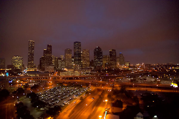 Aerial view of the Houston skyline and freeway traffic from the northwestern side in the early evening.