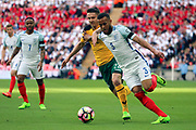 Ryan Bertrand of England taking on Fedor Cernych of Lithuania during the FIFA World Cup Qualifier group stage match between England and Lithuania at Wembley Stadium, London, England on 26 March 2017. Photo by Matthew Redman.