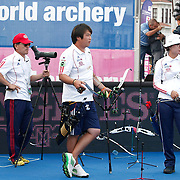 OH Jin-Hyek (KOR) (C) and JUNG Dasomi (KOR) (R) competes in Archery World Cup Final in Istanbul, Turkey, Sunday, September 25, 2011. Photo by TURKPIX