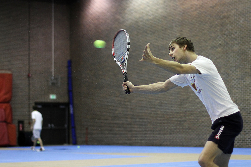 Martin Dluhos returns a volley during Men's Tennis practice in the PEC on March 2, 2010.