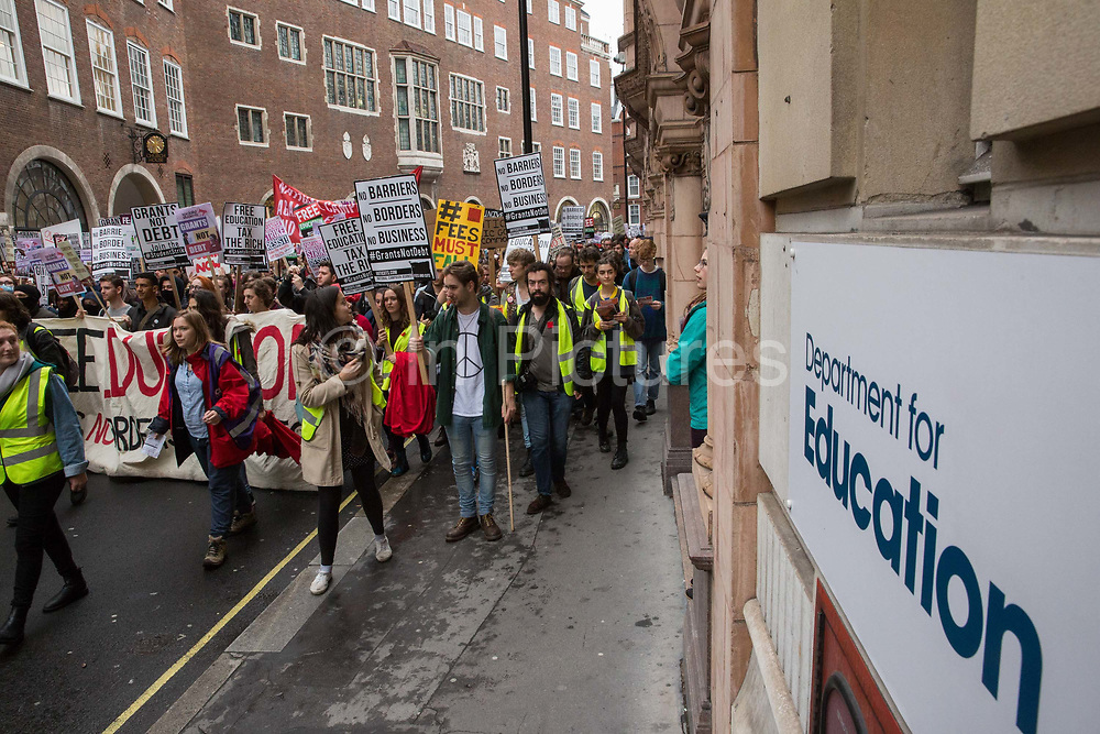 Thousands of students pass the Department for Education during a National Demonstration for a Free Education on 4th November 2015 in London, United Kingdom. The demonstration was organised by the National Campaign Against Fees and Cuts NCAFC in protest against tuition fees and the Government's plans to axe maintenance grants with effect from 2016.