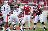 FAYETTEVILLE, AR - OCTOBER 24:  Brandon Allen #10 of the Arkansas Razorbacks at the line of scrimmage during a game against the Auburn Tigers at Razorback Stadium on October 24, 2015 in Fayetteville, Arkansas.  The Razorbacks defeated the Tigers in 4 OT's 54-46.  (Photo by Wesley Hitt/Getty Images) *** Local Caption *** Brandon Allen