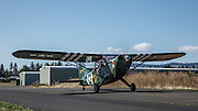 A Stinson L5 Sentinel taxis into the 2013 Hood River Fly In at WAAAM.
