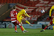 Jack Rudoni of AFC Wimbledon  shoots during the EFL Sky Bet League 1 match between Doncaster Rovers and AFC Wimbledon at the Keepmoat Stadium, Doncaster, England on 26 January 2021.
