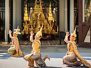 """19 DECEMBER 2016 - BANGKOK, THAILAND: Thai classical dancers perform during the """"Spirit Appeasing"""" Ceremony held for the Royal Chariots at the Bangkok National Museum. The chariots will be used to take the body of Bhumibol Adulyadej, the Late King of Thailand, and members of the Royal funeral cortege to the cremation site on Sanam Luang for His Majesty's cremation. This will be the first cremation of a Thai King since 1950, when King Bumibol's brother, Rama VIII, Ananda Mahidol, was cremated. The design of the royal crematorium is based on Buddhist cosmology, with the main peak of Mount Sumeru (also known as Meru in Hindu cosmology) at center and eight other peaks signifying the levels of the universe. The crematorium will be decorated with mythical creatures such as garuda, angels, and Himmapan Forest creatures. The structure and funeral pyre will stand just over 50 meters tall. The exact date of the King's cremation has not been set yet but is expected to be late next year.     PHOTO BY JACK KURTZ"""