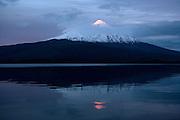 Sunset hitting peak of Osorno Volcano, Lake Llanquihue, Chile
