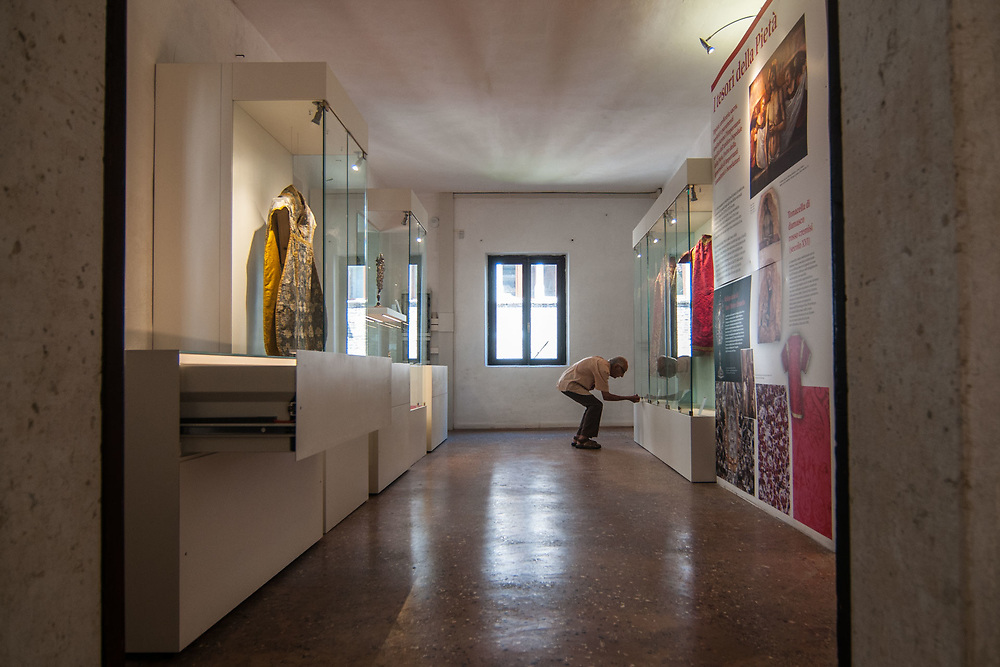 The archivist opens a glass case at the museum ViVe, Vivaldi Venice, at Chiesa della Pietà on July 12, 2017 in Venice, Italy. Chiesa della Pietà has just opened to the public the restored fresco of Tiepolo with the original colors and a museum with original documents of the institution clled La Pietà that in the past hosted abandoned children, and also with original musical instruments used by Vivaldi to teach to the children. ©Simone Padovani