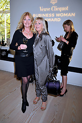 Left to right, DEBBIE MOORE and LIZ BREWER at the presentation of the Veuve Clicquot Business Woman Award 2009 hosted by Graham Boyes MD Moet Hennessy UK and presented by Sir Trevor Macdonald at The Saatchi Gallery, Duke of York's Square, Kings Road, London SW1 on 28th April 2009.