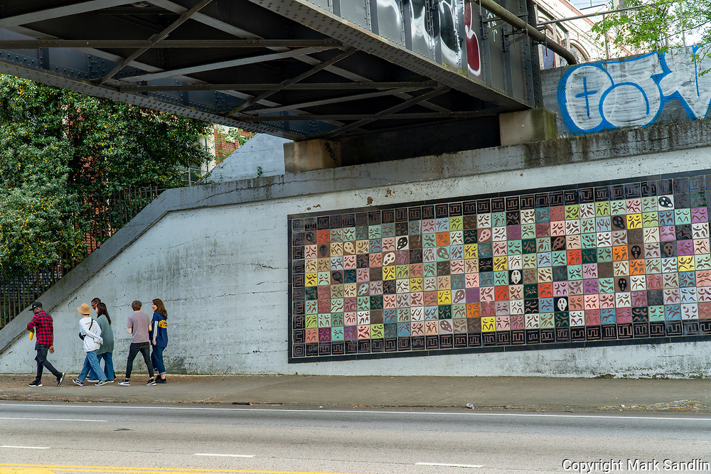 People walking underneath the Atlanta Beltline on Ponce De Leon Ave. Atlanta, Georgia